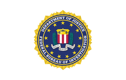 Former FBI agent sues justice department for wrongful termination